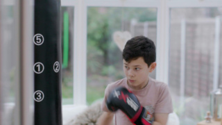 Jake boxing with boxing gloves